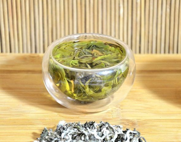 Ancient Artisan Snow Shan Green Tea - crystal clear and bright yellow-green in the cup